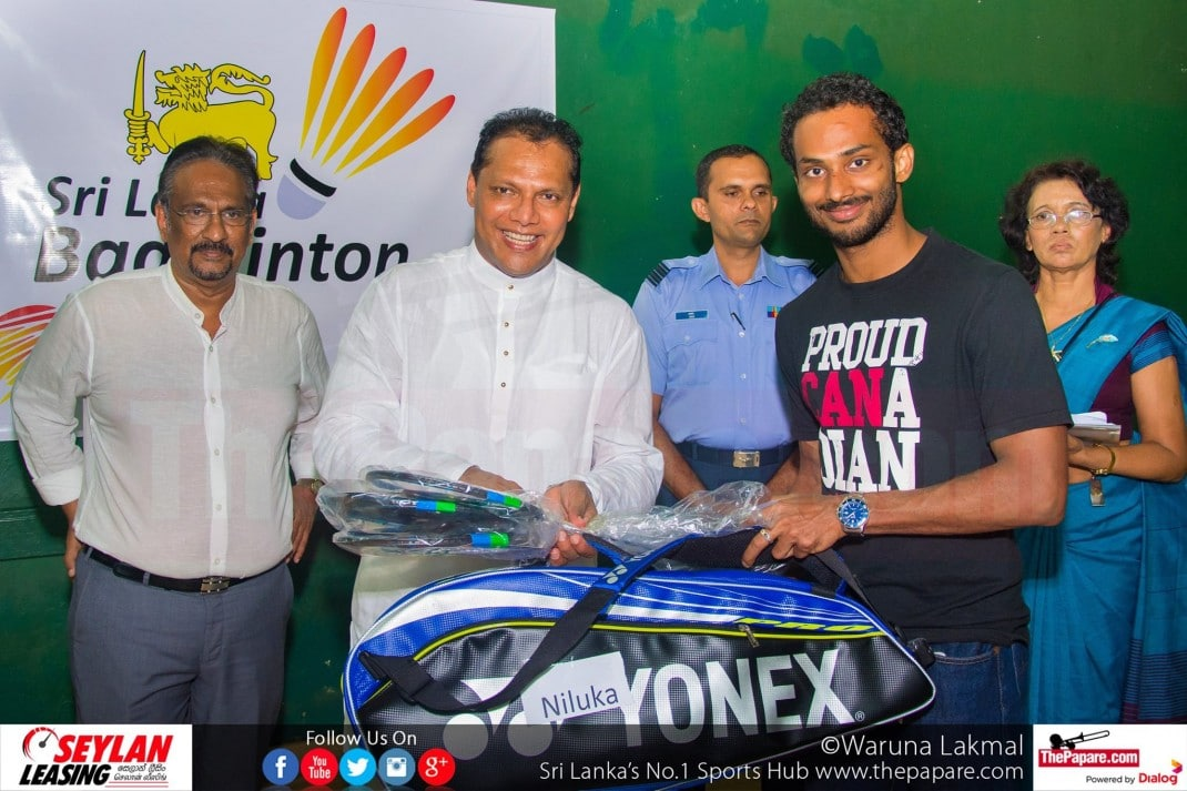 Niluka Karunaratne receiving his equipment from Dayasiri Cover photo