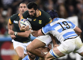 South Africa's centre Damian de Allende (C) is tackled by Argentina's lock Guido Petti Pagadizabal during the bronze medal match of the 2015 Rugby World Cup between South Africa and Argentina at the Olympic Stadium, east London, on October 30, 2015.
