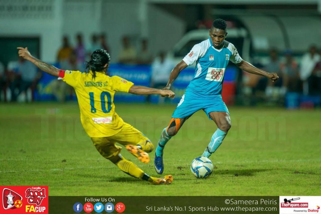Sanoj Sameera (L) makes a tackle on Job Michael (R) - FA Cup 2016 Semi Final