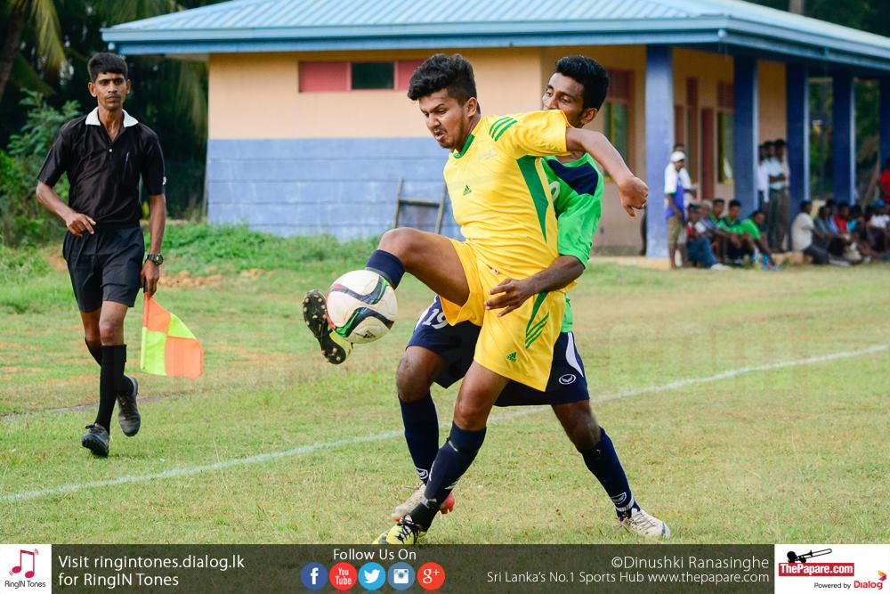 Sarasavi SC player sheperds the ball from a Government Services SC player