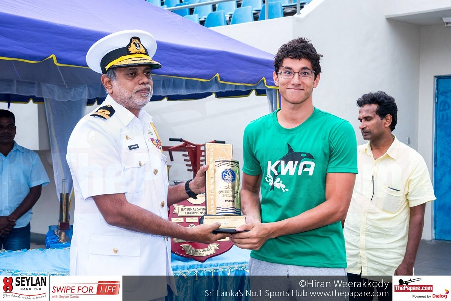 Senior Nationals Best Swimmer - Kyle Abeysinghe receiving his award Caption: Kyle Abeysinghe (R) receiving the award from Cmdr. Jayantha Gamage (L) President SLASU