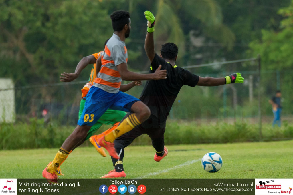 Solid SC's Afis Olayemi scores past the Kirulapone United goalkeeper - FA Cup (Last 32 Round)