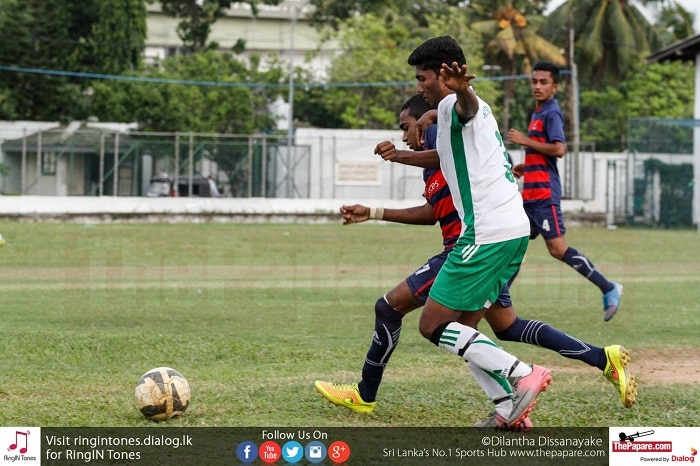 St.Benedict's player (L) and a Kingswood player (R) tussling for the ball - Schools Football 2016