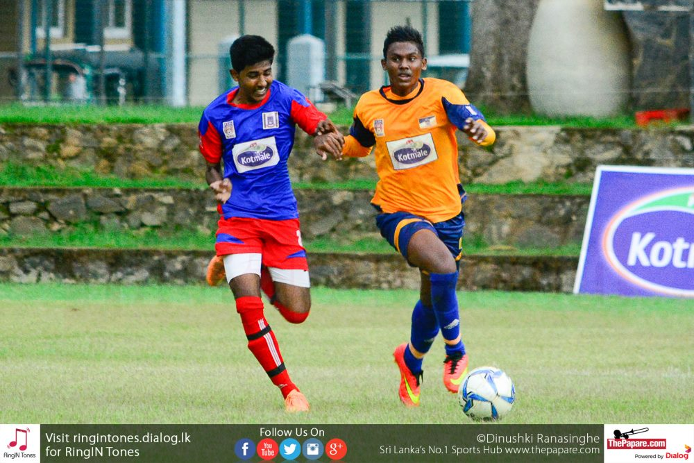 St.Peter's College's Mohamed Shabeer (R) in action against Maris Stella - Schools Football 2016