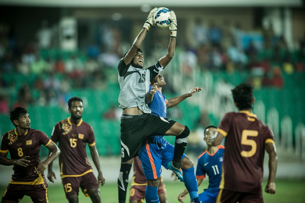 Sujan Perera intercepting a cross. (Photo - SAFF Suzuki Cup)