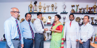 Antonians hand over donations to Science player