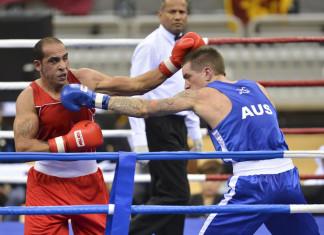 Udeni refereeing an International bout