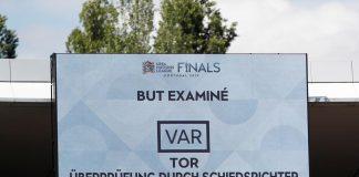 The big screen confirms a VAR review