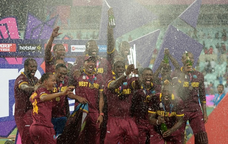 West Indies's captain Darren Sammy (C) holds the trophy after winning the World T20 cricket tournament final match between England and West Indies at The Eden Gardens Cricket Stadium in Kolkata on April 3, 2016. / AFP / Dibyangshu SARKAR