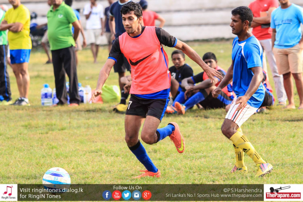 Yusuf Rahman dribbles past a Piliyandala Town FC defender