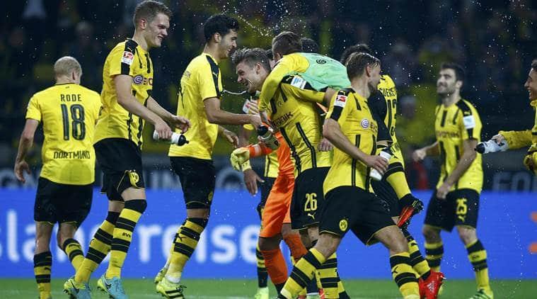 Dortmund beat Freiburg 3-1 to join Bayern on top