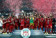 Liverpool's Sadio Mane lifts the trophy as he celebrates winning the UEFA Super Cup with team mates