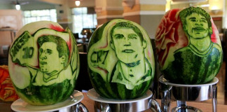 Watermelons with the carvings of (L to R) Argentina's Lionel Messi, Portugal's Cristiano Ronaldo and Brazil's Neymar are seen at San Raphael hotel in Sao Paulo May 7, 2014. REUTERS/Paulo Whitaker