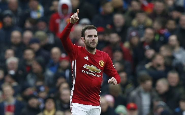 Manchester United ease past Watford to reach points landmark