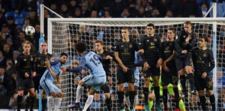 Manchester City's Leroy Sane shoots from a free kick