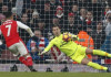 Arsenal's Alexis Sanchez scores their second goal from the penalty spot