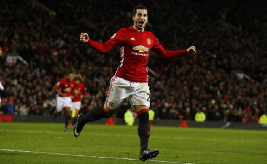 Manchester United's Henrikh Mkhitaryan celebrates scoring their third goal