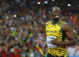 Usain Bolt of Jamaica smiles after running the anchor leg to win the men's 4 x 100 metres relay final at the 15th IAAF Championships at the National Stadium in Beijing, China August 29, 2015. REUTERS/Kai Pfaffenbach