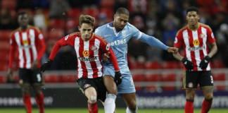 Stoke City's Glen Johnson in action with Sunderland's Adnan Januzaj