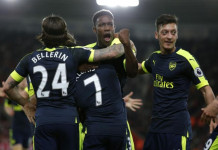 """Britain Football Soccer - Southampton v Arsenal - Premier League - St Mary's Stadium - 10/5/17 Arsenal's Alexis Sanchez celebrates scoring their first goal with Danny Welbeck and team mates Action Images via Reuters / Andrew Couldridge Livepic EDITORIAL USE ONLY. No use with unauthorized audio, video, data, fixture lists, club/league logos or """"live"""" services. Online in-match use limited to 45 images, no video emulation. No use in betting, games or single club/league/player publications.  Please contact your account representative for further details."""
