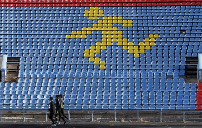 Sportsmen train at a local stadium in the southern city of Stavropol