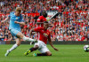 City edge United in derby clash, Arsenal leave it late