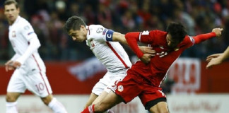 Robert Lewandowski struck in the fifth minute of stoppage time to give Poland a dramatic 2-1 home win over 10-man Armenia in a World Cup Group E qualifier on Tuesday.