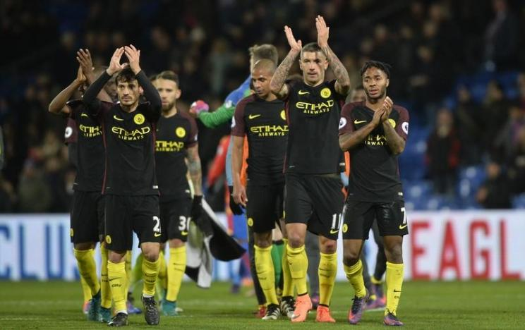 Toure back with bang as Man City join Liverpool on top