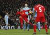 Liverpool's Alberto Moreno shoots at goal