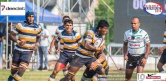 Ashel Ranasinghe of St. Peter's College Rugby in action as referee Priya Suranga looks on