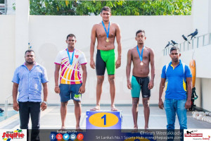 Figure SEQ Figure * ARABIC 1Dilanka Shehan receiving his medal for the 800m Freestyle (M). Left is Manula Coorya (silver) and right Amrith Perera (bronze)