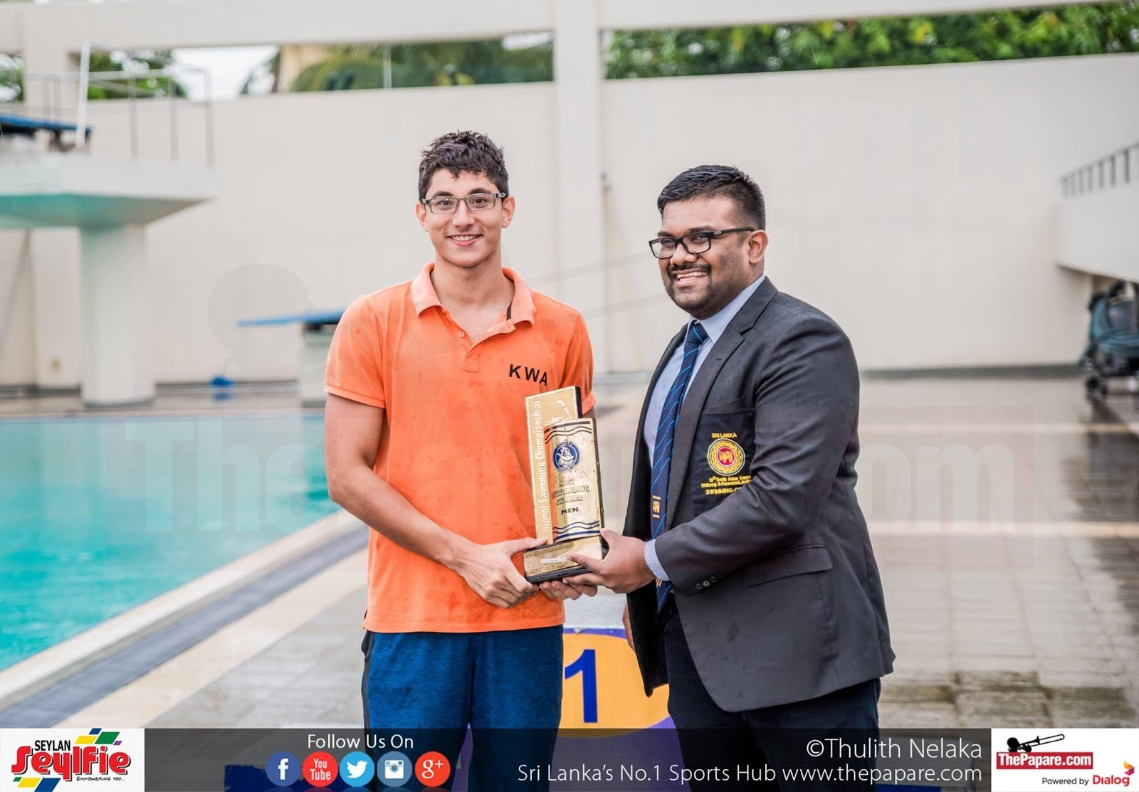 Kyle Abeysinghe getting his Best Swimmer award from Secretary SLASU Migara Gunathilake (R)