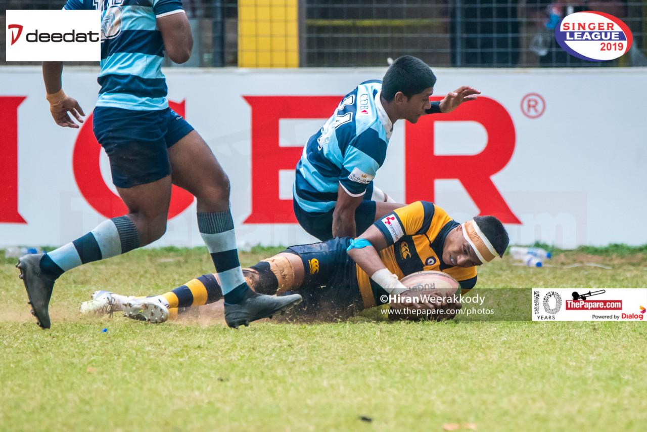 Royal's Kalindu Nandila crossing over for the try