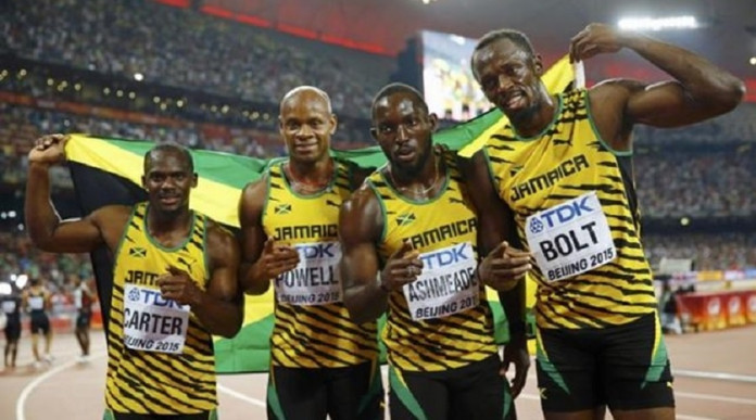 Jamaica's team Nesta Carter, Asafa Powell, Nickel Ashmeade and Usain Bolt pose for photographers after winning the men's 4 x 100 metres relay final during the 15th IAAF World Championships at the National Stadium in Beijing