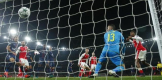 Arsenal's Alex Iwobi scores an own goal and the second goal for Paris Saint-Germain