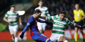 Barcelona's Lionel Messi in action with Celtic's Emilio Izaguirre
