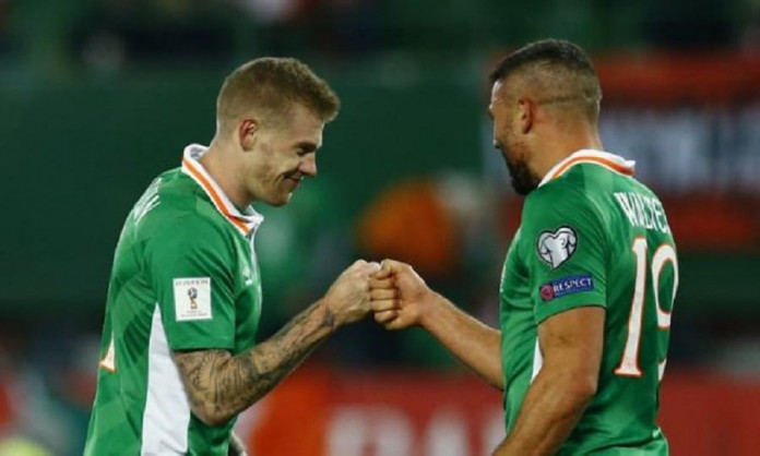Republic of Ireland's James McClean celebrates after the game with Jonathan Walters