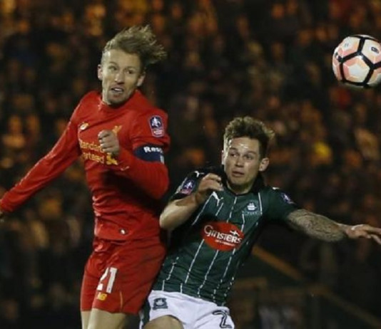 Plymouth Argyle's David Fox in action with Liverpool's Lucas Leiva